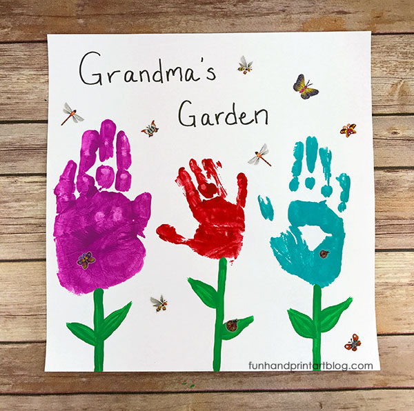 Grandma handprint garden craft - With Mother's Day right around the corner, we can't forget the special woman who started it all - Grandma! Kids are so fortunate if they have a grandma in their lives.  These Mother's Day crafts for Grandma are such a heartfelt way to show her some well-deserved love!