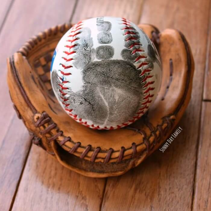 Handprint Baseball Father's Day Gift - I don't if anything warms the heart quite like a homemade gift from your kiddo! Father's Day is no exception - here are 25 homemade Father's Day gifts from kids  - and ones that Dad can actually use!  Keep reading to check them out!