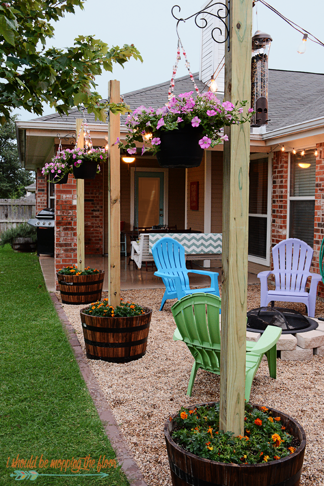 Colorful adirondack chairs flowers backyard patio summer - If you are wanting a perfect space to relax and enjoy during the warm summer days, I've got your covered! Inside is EVERYTHING you need to make your backyard and patio your most favorite place the entire summer!