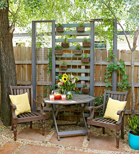 summer backyard patio - wall planter dividers with armchairs and table
