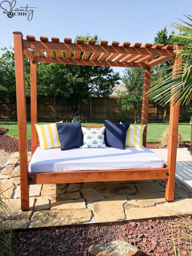 Outdoor DIY daybed in pergoal with blue and yellow cushions