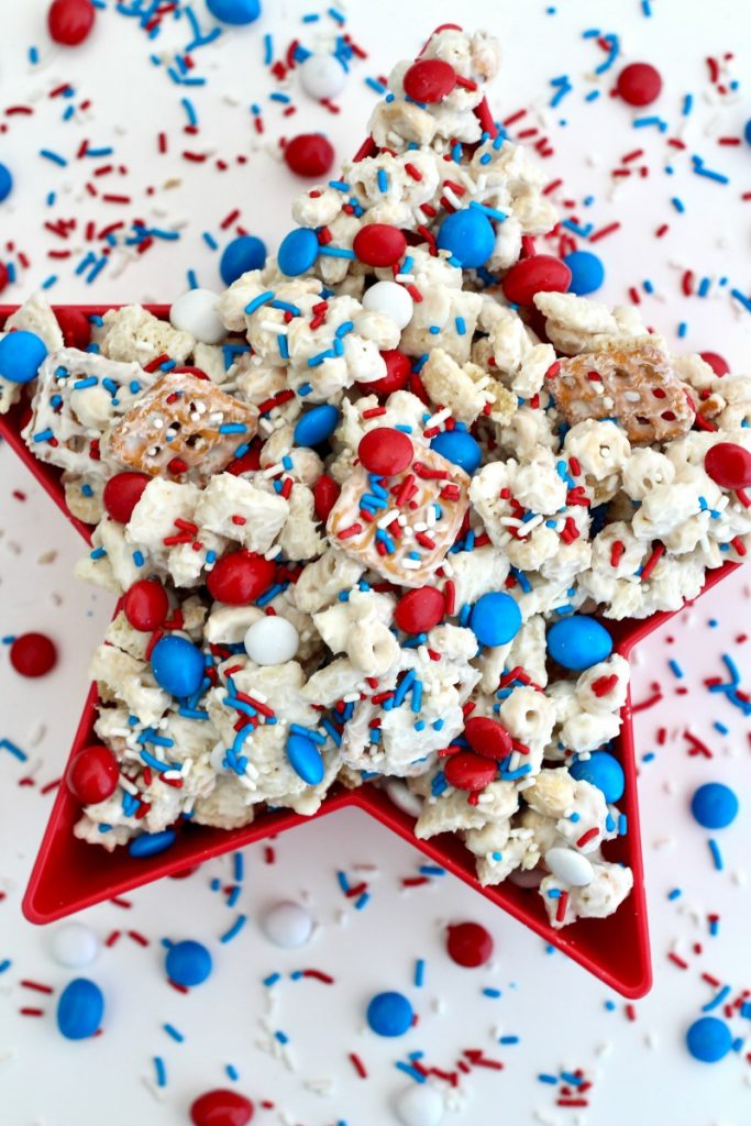 Patriotic Party Mix with pretzels, Chex mix, white chocolate, marshmallows and red, white, blue M&Ms