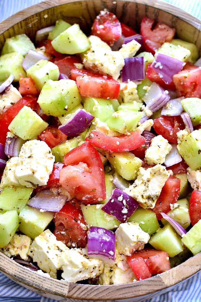 Tomato Cucumber Feta Salad - If you are dreading the idea of cooking in a hot kitchen this summer, I've got you covered!  Take a look at these 30 refreshing summer salads! These recipes are easy, healthy and filling!  Keep reading to learn more!