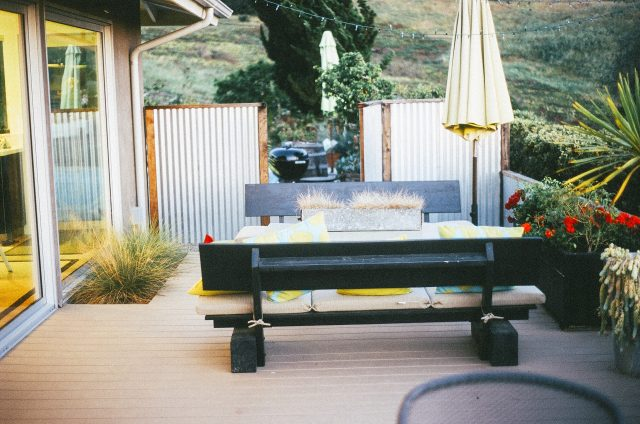 backyard patio dining area - picnic table with cushions