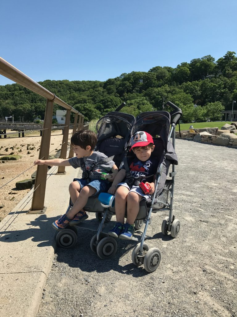Little boys in stroller at park - Are you already counting down the days the kids go back to school? Has the summer crazy with the kids wearing you out all ready? Keep reading for 5 ways you can hit a reset after a rough day and end the day on a high note! #parenting #kids #familytime #summer #NeverFlySolo #RedBaronPizza #sponsored