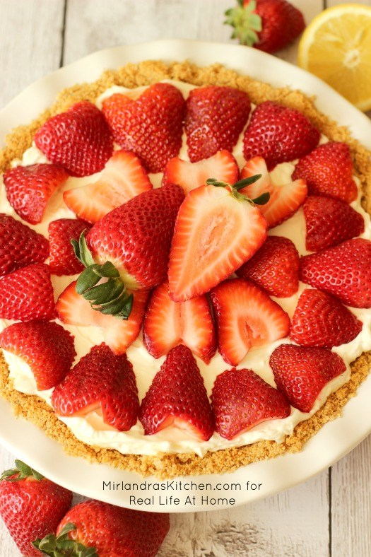 No Bake Strawberry Cheesecake - from Real Life at Home: Summer = strawberry season! Looking for some ways to use those yummy berries? Here are 25 summertime recipes for amazing strawberry desserts and treats!
