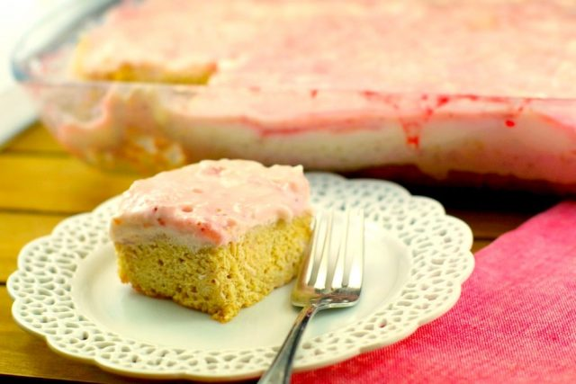 Slightly SKinny Strawbery Blondies on white cake plate with fork, from Food Meanderings: