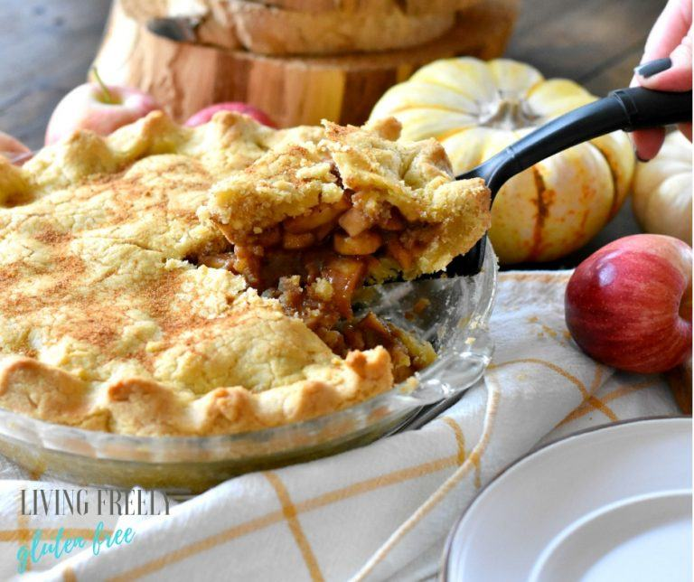paleo apple pie with slice on pie cutter lifted from pie dish