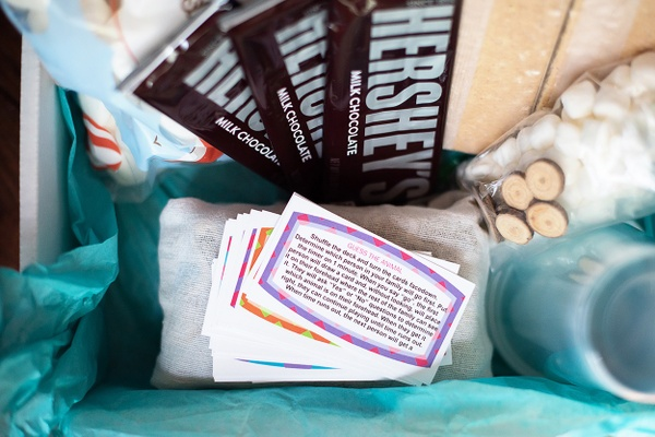 Family Faith Box Subscription Box for Christian Families, displayed with Bible verse cards, conversation starters, Hershey's Chocolate Bars, and activity materials