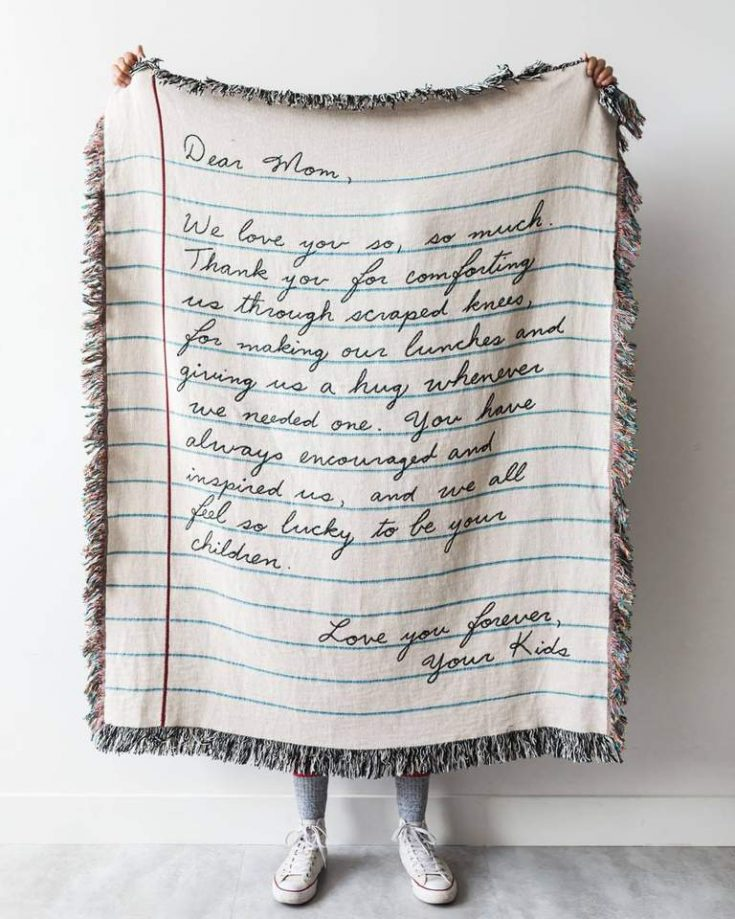 Love Letter Blanket - personal letter printed on blanket, held up and displayed by a person behind it - the perfect meaningful gift for a really special person!