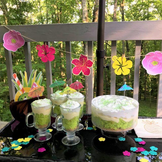 Luau backyard decorations with key lime coconut trifle parfaits on table