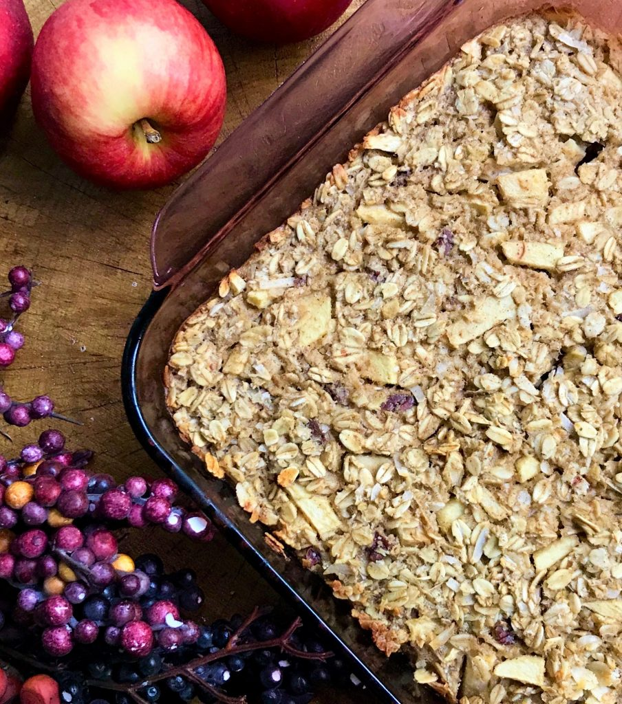 close up corner picture of apple baked oatmeal with apples and fall berries