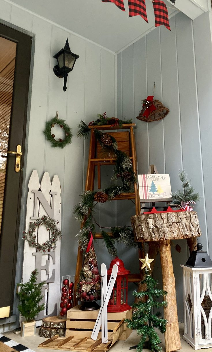Farmhouse Christmas porch decor with DIY NOEL wooden sign, decorated ladder, mini trees, flocked garland - perfect easy and cheap Christmas decor idea!