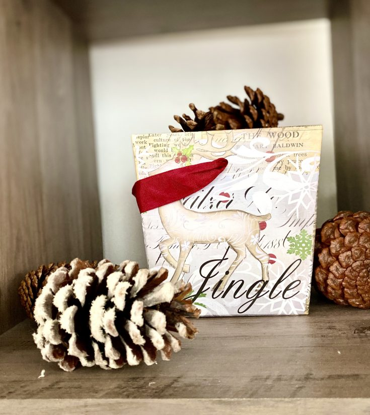 Rustic farmhouse container with reindeer filled with pine cones - perfect easy and cheap Christmas decor idea!