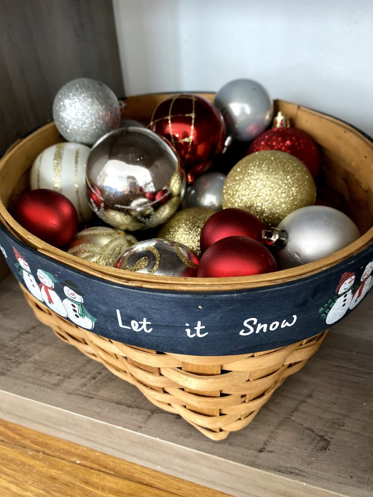Rustic farmhouse Let it Snow basket filled with red, gold and silver ornaments - perfect easy and cheap Christmas decor idea!