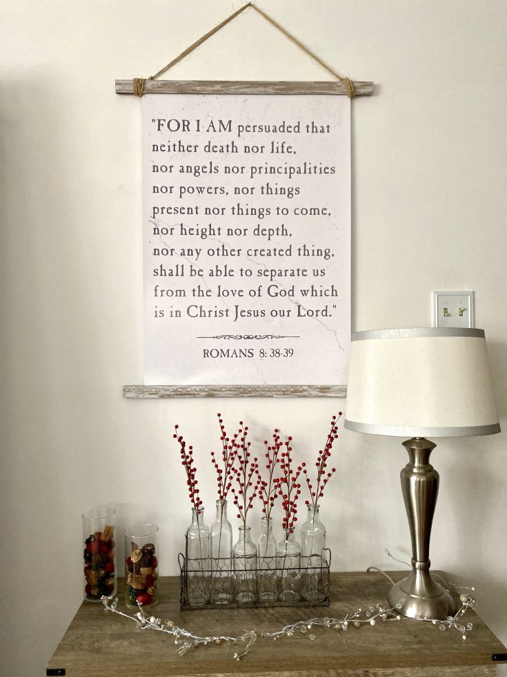 DIY scroll frame and Romans 8:38-39 print with rustic bench with glass jars and berries and icicle garland