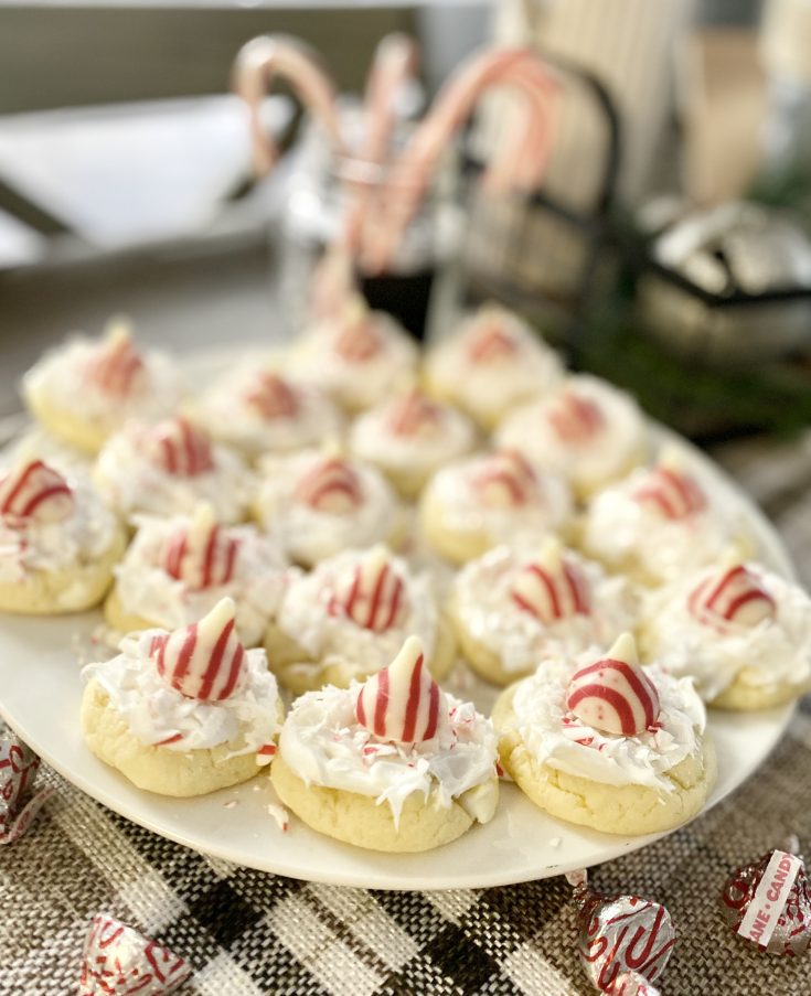 North Pole Cake Mix Christmas cookies on plate with with Hershey's Candy Cane Hug, frostings, coconut, candy cane bits