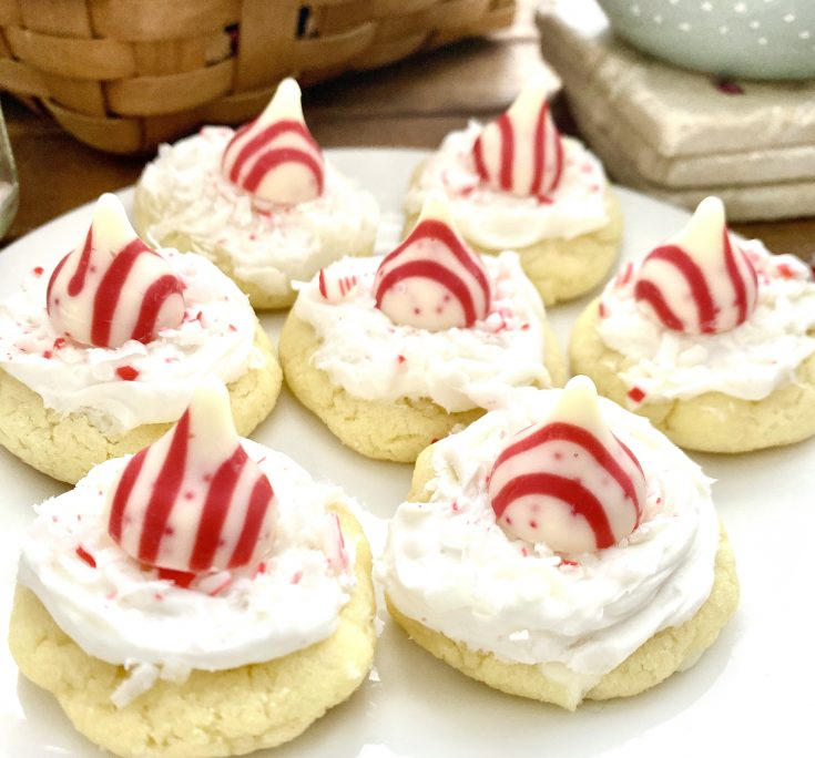 Candy Cane hug on top of white cake mix cookie with white frosting, coconut and candy cane bits