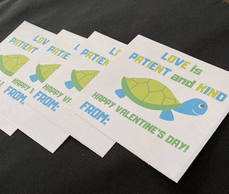 Turtle Love is Patient and Kind free printable Valentine's Day card for kids, 3 laid out on table